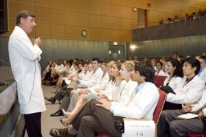 Doctor in front of lecture hall of med students