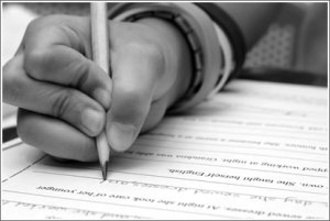 Black and white pictures of a hand writing on a test