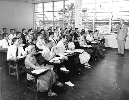 Old black and white picture of students in lecture hall