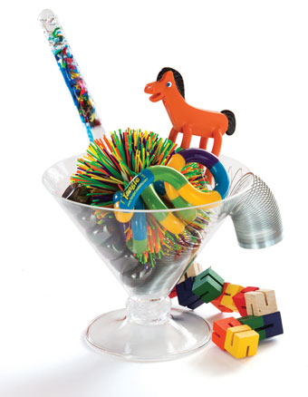 Clear cup of fidget toys - slinky, koosh ball, little toy animals...