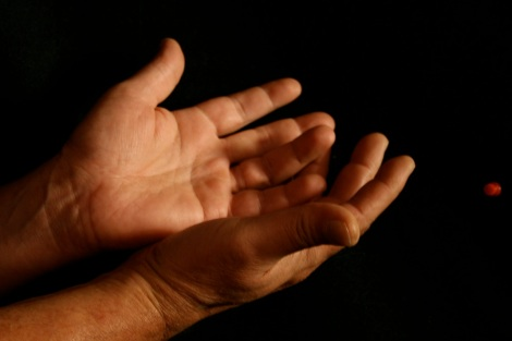 "Two hands, palms oriented up, held together in a sort of ""bowl"" or ""giving"" gesture."