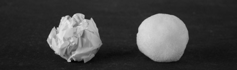 ball of crumpled paper next to a snowball