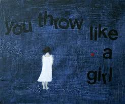 "Blue background with a drawing of a white girl in a white dress facing away.  Text says ""you throw like a girl."""