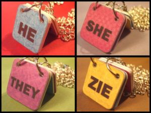 "A group of four images.  Each image has a colorful ""namecard"" with a pronoun on it and is surrounded by gold chain.  The pronouns depicted are ""he,"" ""she,"" ""they,"" and ""zie."""